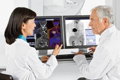 Radiologists looking a x-ray scans