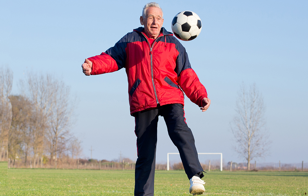 Senior playing soccer