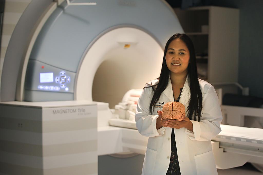 Cassandra Leonardo in front of MRI machine