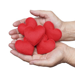 elderly woman holding red hearts