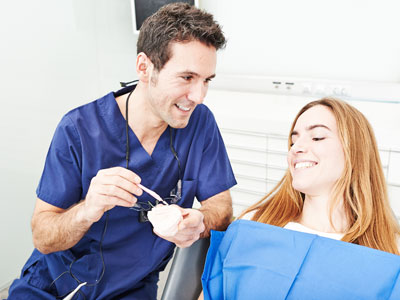Prosthodontists are specialists at complicated tooth replacement, such as partial dentures, replacement dental implants or implant restorations.