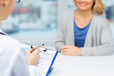 Image of woman consulting with doctor