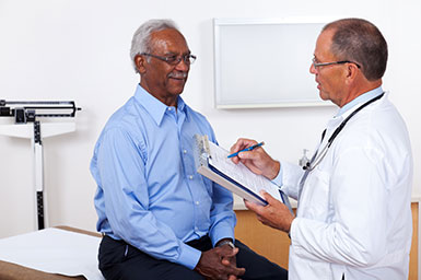 Physician speaking with elderly patient