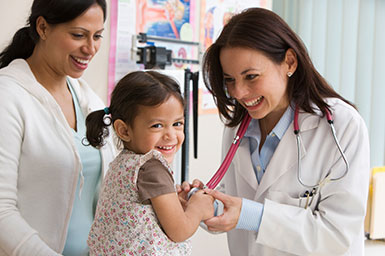 Image of doctor with young child and mother