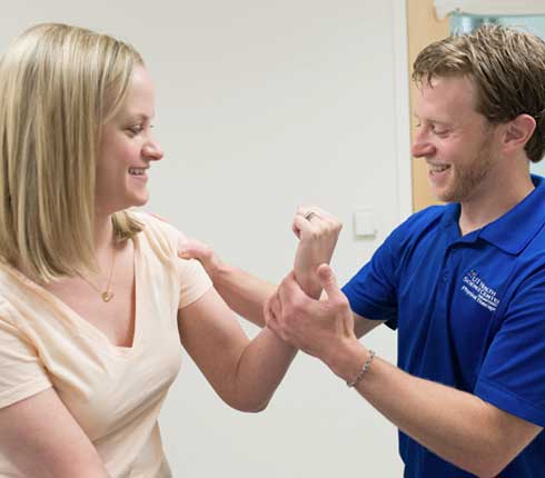 Corey Mowen physical therapist with a patient
