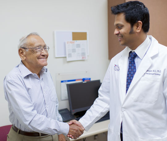 Dr. Mahalingam meeting with colorectal clinic patient