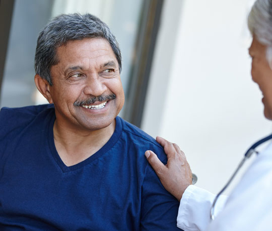 Smiling man with physician