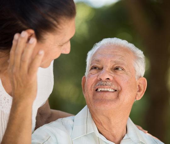 Elderly man smiling at daughter