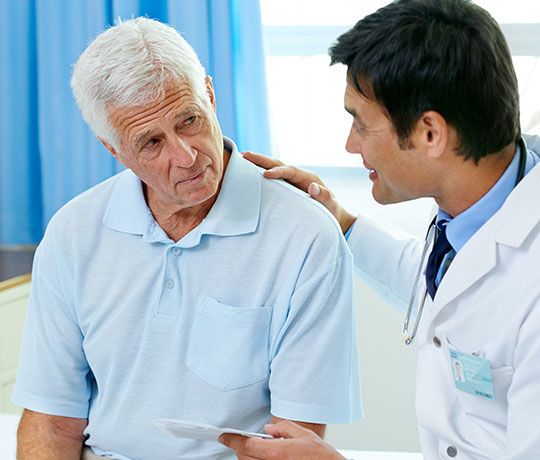 Male doctor with mature patient