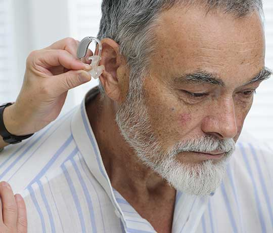 Man getting fitted for hearing aids