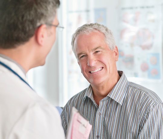 Mature man with doctor