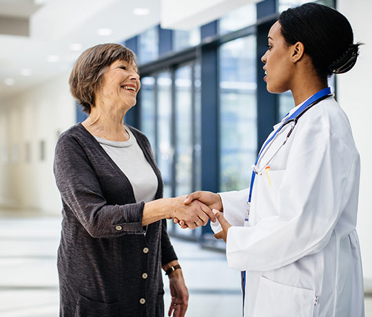 Female doctor with patient