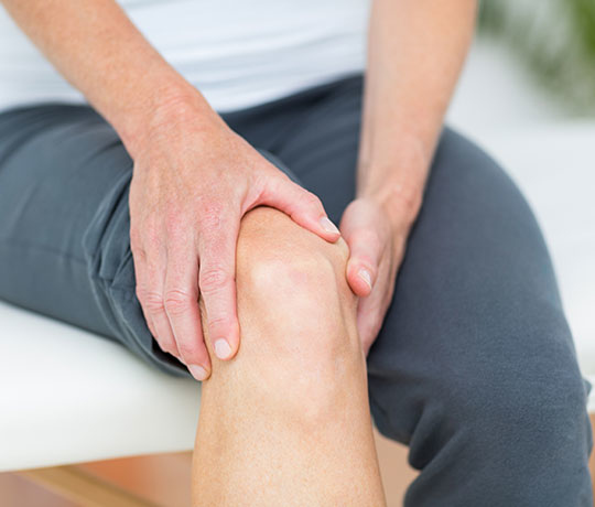 Patient holding knee