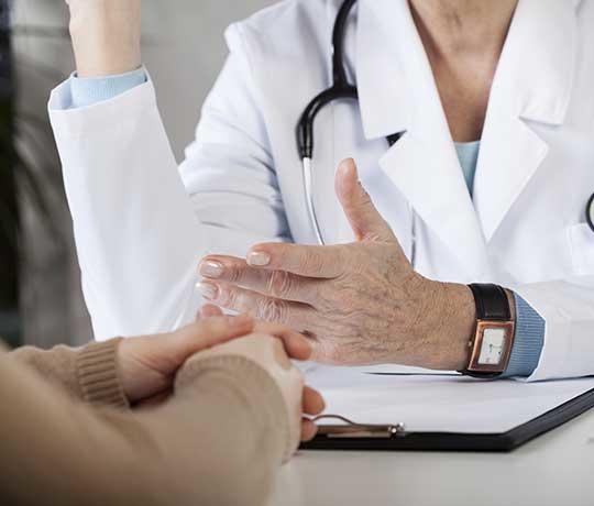 Specialist speaking to patient