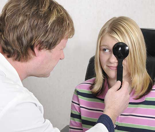 Pediatric patient with eye doctor