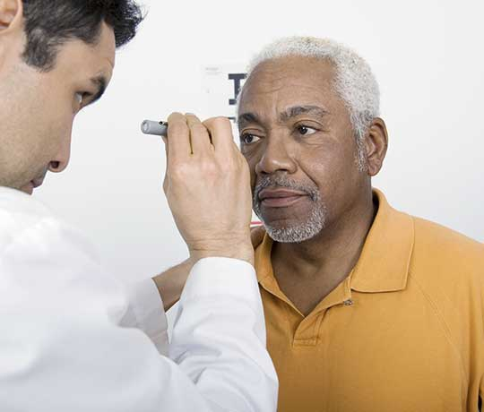 Patient being examined by ophtalmologist