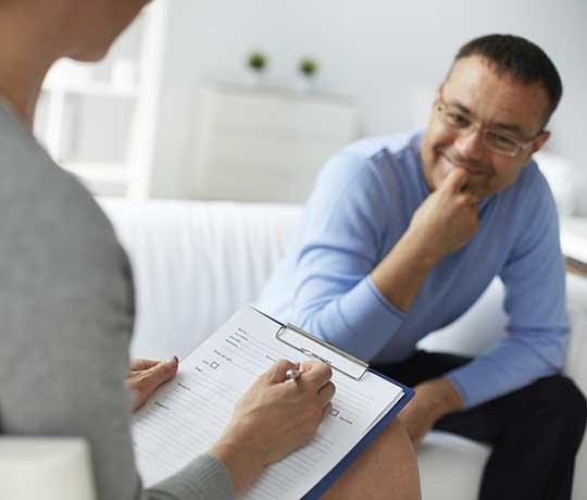 Man speaking with psychiatrist