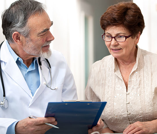 Physician consulting with older female patient
