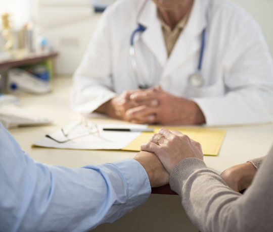 Couple meeting with doctor
