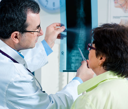 Scoliosis specialist with patient