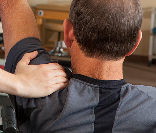 Man getting physical therapy treatment