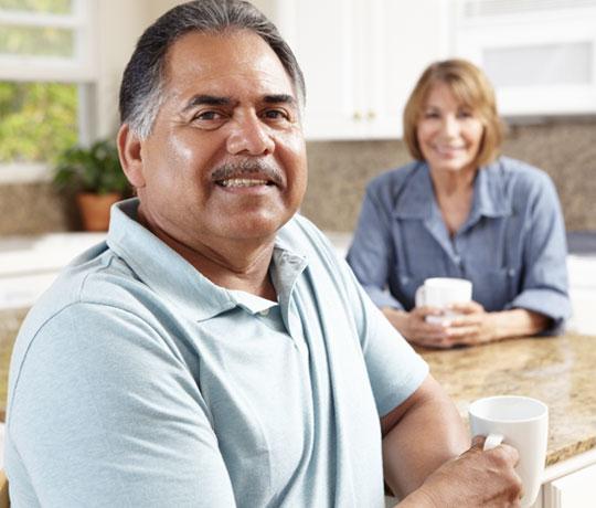 Husband having tea with wife