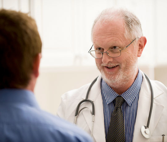 Mature doctor and patient