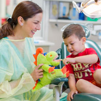 pediatric dentist Dr Maria Cervantes with one of her patients