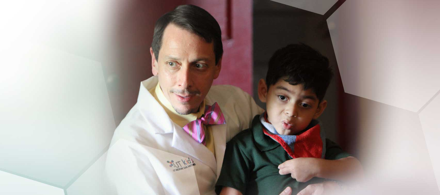 Dr. Medellin and young male patient  Dr. Glen Mendellin treats pediatric cerebral palsy patients.