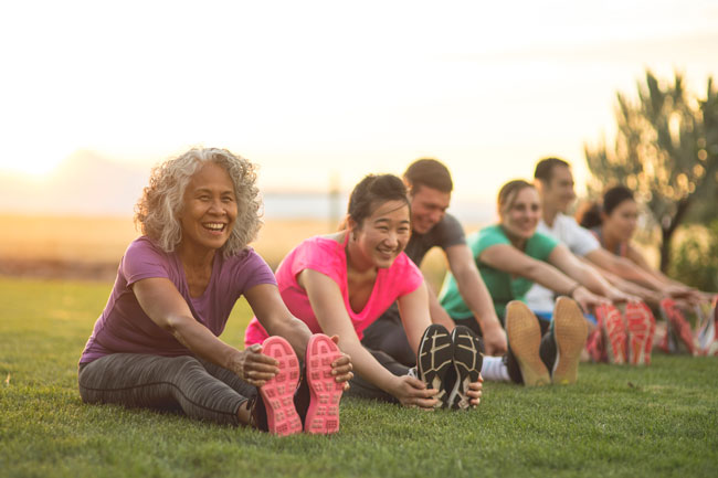 Group of people exercising outside