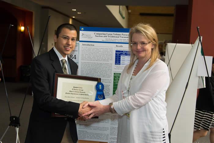 Medical student winner shaking hands with Dr. Potter