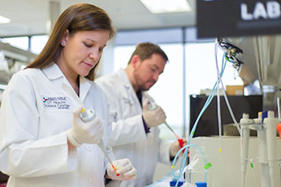 Graduate School of Biomedical Sciences UT Health Science Center San Antonio researchers in lab