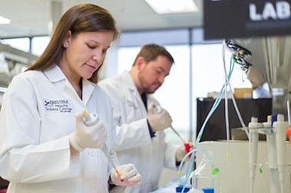 Graduate School of Biomedical Sciences UT Health Science Center San Antonio researchers in lab
