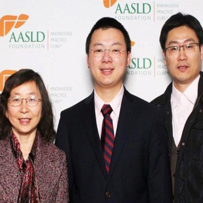 Mengwei Zang, M.D., Ph.D., of UT Health San Antonio, with fellow researcher Hanqing Chen, Ph.D., center, and Feng Shen, MD, PhD