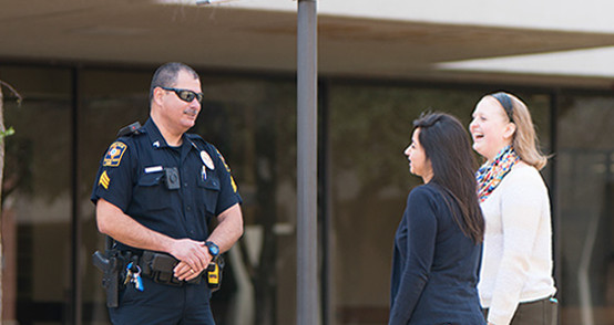 Campus crime prevention officer helping UTHSCSA students