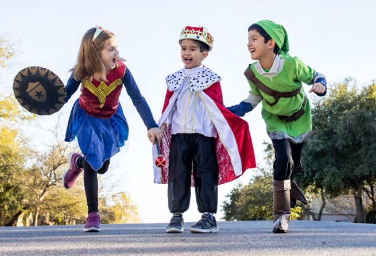 3 children playing in costumes