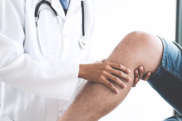 physician examining knee