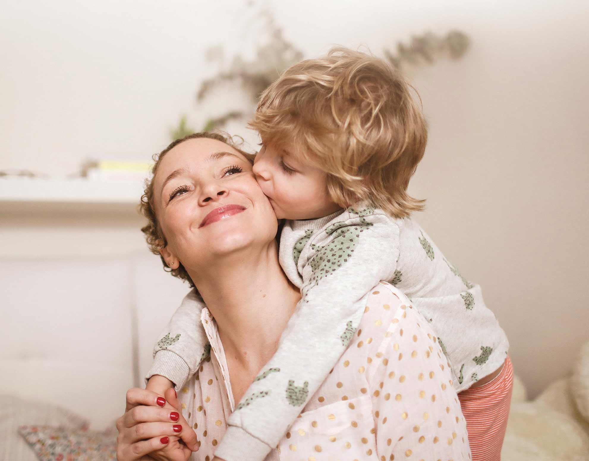 Woman and child hugging