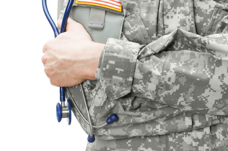 military doctor holding stethoscope