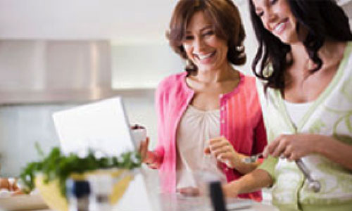Two women in kitchen cooking