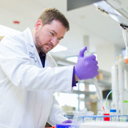 researcher in lab studying Parksinson's-affected cells