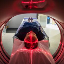 patient lying inside medical scanner