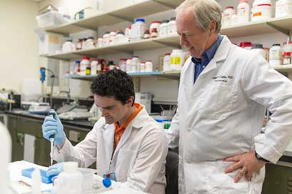 William P. Clarke, Ph.D., professor of pharmacology, is an outstanding mentor to students as he conducts research to find locally acting, safer drugs for pain relief.