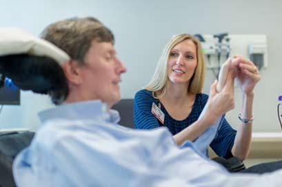 Autumn Clegg with patient at UT Medicine