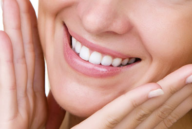 Closeup of a dental implant restoration patient smiling