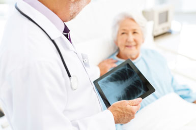 Physician consulting with elderly patient