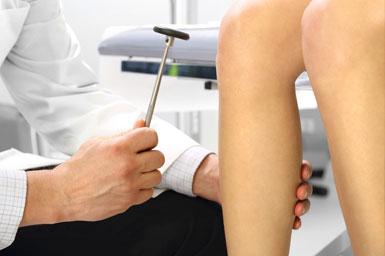 Physician checking reflexes