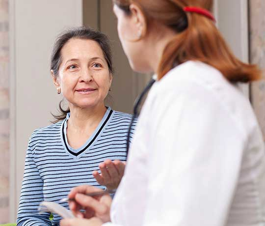 Patient visting with a physician