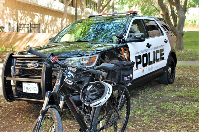 Campus police patrol officers in cruiser at UT Health San Antonio