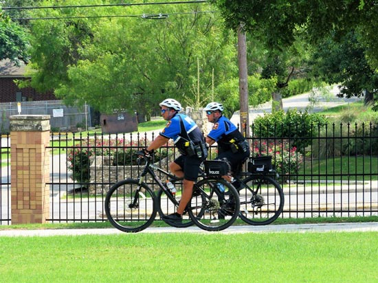 Campus police patrol officers on bicycles at UT Health San Antonio